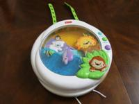 fisher price crib toy soother with music and lights.
