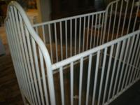 White metal crib, in nice shape. The pics show the crib