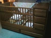 Solid wood crib/youth bed. Needs mattress but mattress