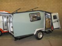 2014 Cricket Trailer 148 in Green with Tongue Box Roof