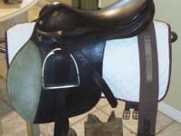 "18"" seat. Saddle in good condition. Has 2 patches on"