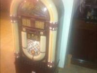 This is a pristine Crosley CD player Jukebox with