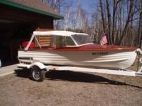 This is a 1955 Lapstrake Runabout with 1960 35 HP