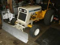 THIS IS A 1973 CUB 154 LOW BOY WITH FRONT SNOW PLOW AND