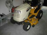 like new mower needs nothing, cost of a new 1 2400.00,