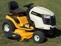 Here is a near new, sharp Cub Cadet LTX1050 lawn mower