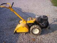 Reartine tiller 6.5 HP has forward and reverse digging.