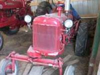 Cub internationl tractor from the 50 runs good 5 foot