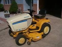 this is a super nice cubcadet 1864 garden tractor,