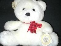 "This beautiful soft white bear rests 91/2"" tall. He is"