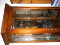 Curio Cabinet is in like new condition. it stands about
