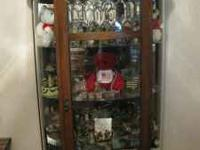Solid Oak Curio Cabinet for 200.00. Items in cabinet