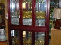 Beautiful Curio Cabinet will perfectly display your