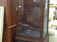 2-piece curio cabinet. Upper unit with glass sides.