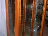 This is a Beautiful glass Curio Cabinet. It has solid