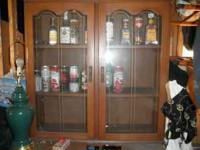 NICE CURIO CABINET. GLASS DOORS ON TOP AND 3 DRAWERS