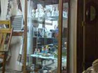 Curio Cabinet in very good condition. Glass front with