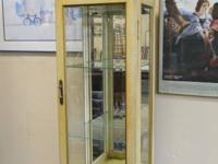 Curio cabinet with glass shelf's and light. Has the