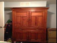 Large, but not heavy curio for sale. Will hold a TV or