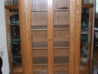 Lighted curio cabinet with wooden racks and 2 glass