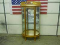 This is a most unusual curio cabinet. Half moon design,