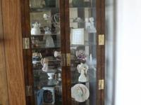 Beautiful lighted curio cabinet. With glass shelves. In