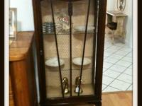 The curio cabinet comes with 3 glass shelves and the