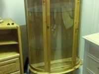 Very nice 3 shelved curio cabinet with bowed front