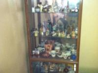 mirrored back Curio cabinet and contents which include