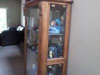 This is a Solid wood Curio Cabinet and in perfect