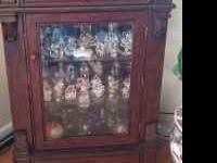 Beautiful curio cabinet with two drawers for storage.