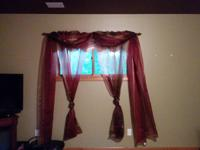 3 sets of sheer maroon and gold curtains.  Iridescent