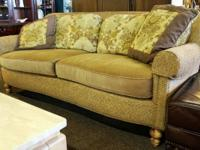 C. R. Laine curved sofa upholstered in a light brown