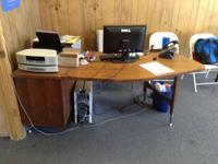 I am selling a curved wooden desk. The desk has