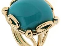 This unique ring features a cushion Turquoise cabochon