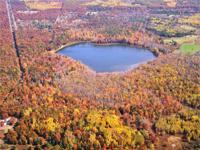 1200 +/- acres with personal all-sports Woodruff Lake.