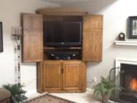 This is a beautiful oak corner cabinet custom made by
