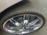 A full set of four dub nasty six custom rims, plus a