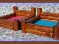 Sturdy, hand made log cabin style beds come with water
