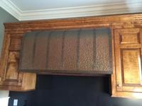 Beautiful, custom made, hammered copper range hood.