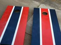 Selling two brand new sets of hand painted cornhole