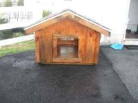 this is a custom amish built dog-house , huge well