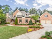 This custom, four sides brick home on a golf course lot