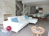 This immaculate, custom european 2-story condo with a