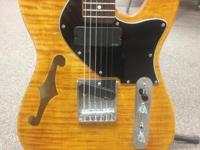 I have a custom Thinline F-hole style semi-hollowbody