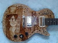 Up for sale ,this hand made Gibson custom wood burn