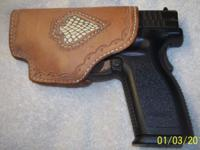 This holster is a left hand leather hand sewed holster.