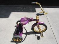 Custom hand painted tricycle in purple and gold. In