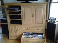 Custom built solid oak entertainment center - $125 A