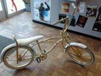 Gold Bike with white tires and fenders. Music Symbols